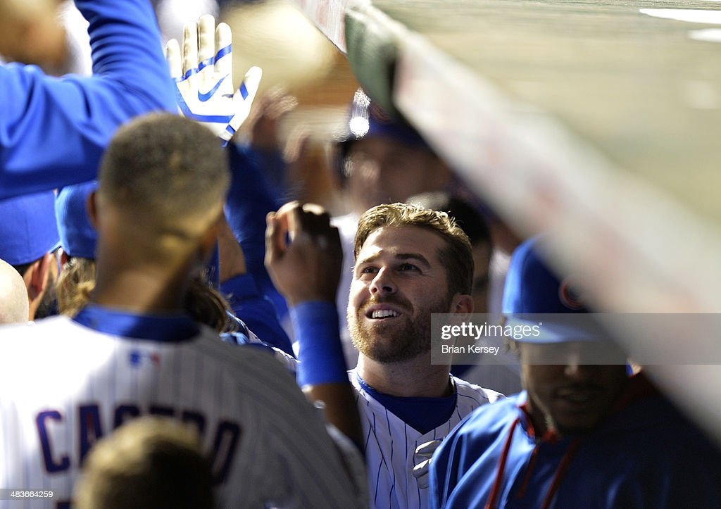 <a gi-track='captionPersonalityLinkClicked' href=/galleries/search?phrase=Mike+Olt&family=editorial&specificpeople=9013251 ng-click='$event.stopPropagation()'>Mike Olt</a> #30 of the Chicago Cubs is greeted in the dugout after hitting a two-run home run scoring teammate Anthony Rizzo #44 during the fifth inning against the Pittsburgh Pirates at Wrigley Field on April 9, 2014 in Chicago, Illinois.