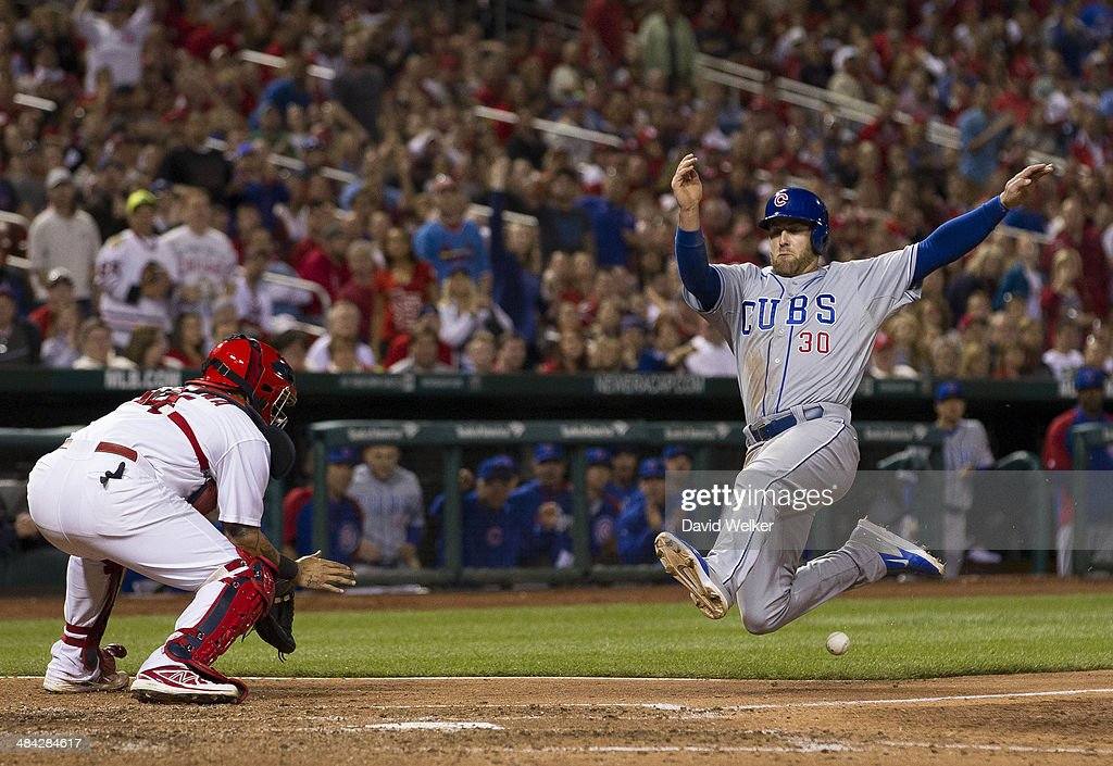 <a gi-track='captionPersonalityLinkClicked' href=/galleries/search?phrase=Mike+Olt&family=editorial&specificpeople=9013251 ng-click='$event.stopPropagation()'>Mike Olt</a> #30 of the Chicago Cubs slides into home plate to score in the eighth inning during a game against the St. Louis Cardinals at Busch Stadium on April 11, 2014 in St. Louis, Missouri. The Cubs defeated the Cardinals 6-3 in eleven innings.