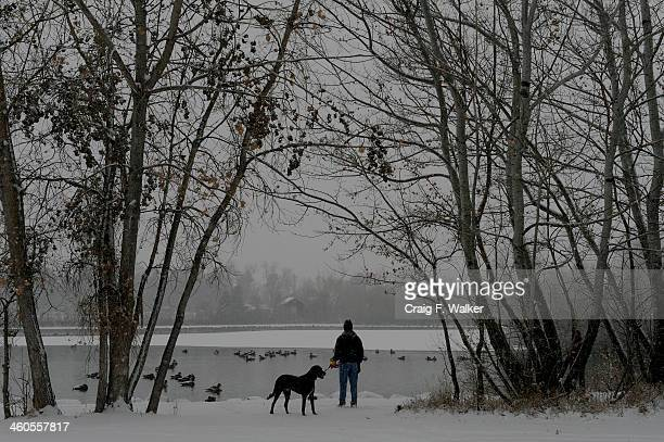 Mike Ostberg takes in the view at Ketring Park while walking his dog Ranger in Littleton CO January 04 2014 Temperatures will linger in the low 20s...