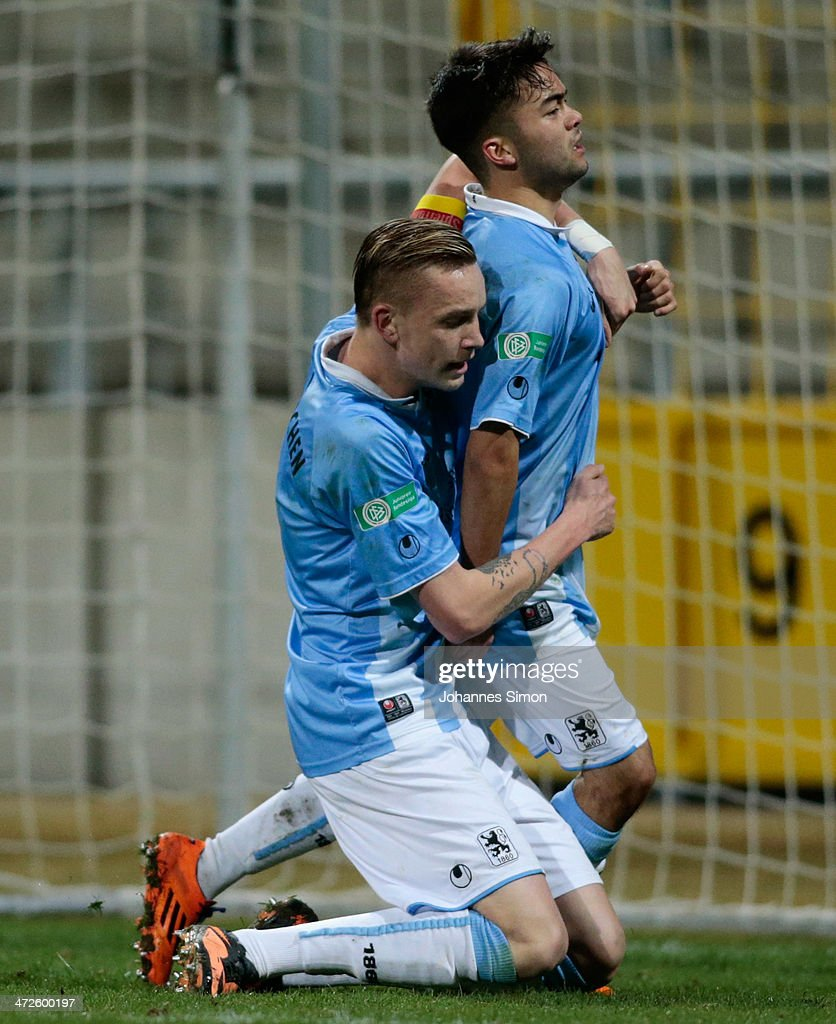 Mike Ott (R) of 1860 Muenchen celebrates with team mate Marius Wolf after scoring his team's 4th goal during the A Juniors Bundesliga match between 1860 Muenchen and Bayern Muenchen at Stadion an der Gruenwalder Strasse on February 21, 2014 in Munich, Germany.