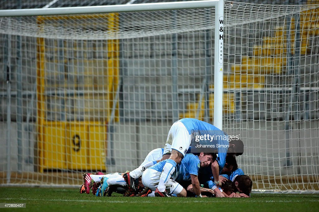 Mike Ott (R) of 1860 Muenchen celebrates with team mates after scoring his team's 4th goal during the A Juniors Bundesliga match between 1860 Muenchen and Bayern Muenchen at Stadion an der Gruenwalder Strasse on February 21, 2014 in Munich, Germany.