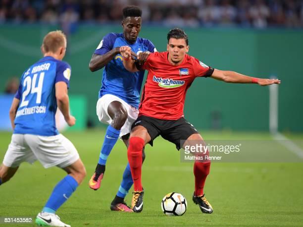 Mike Owusu of FC Hansa Rostock and Karim Rekik of Hertha BSC during the game between FC Hansa Rostock and Hertha BSC on August 14 2017 in Rostock...