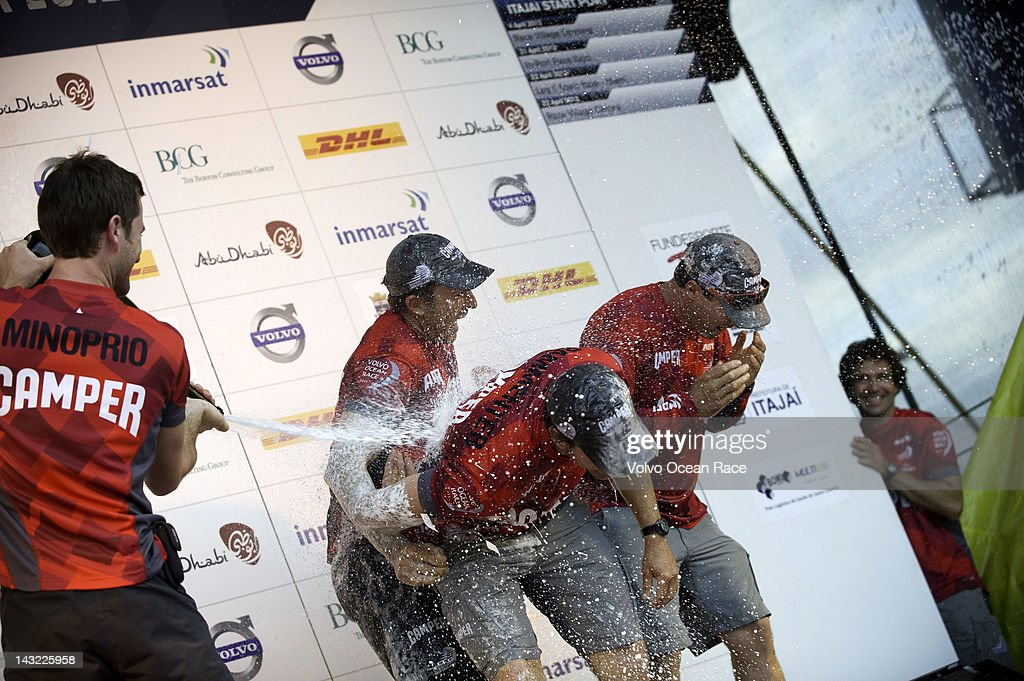 Mike Pammenter from South Africa is sprayed with champagne as CAMPER with Emirates Team New Zealand, skippered by Chris Nicholson from Australia celebrate coming second in the DHL In-Port Race in the Volvo Ocean Race 2011-12 on April 21, 2012 in Itajai, Brazil.