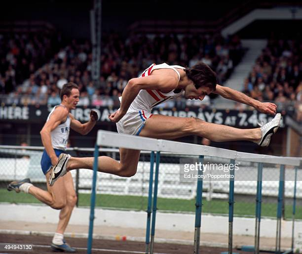 Mike Parker of Great Britain participating in the men's 110 metres hurdles event during the InterCounties Athletics Championships at White City in...