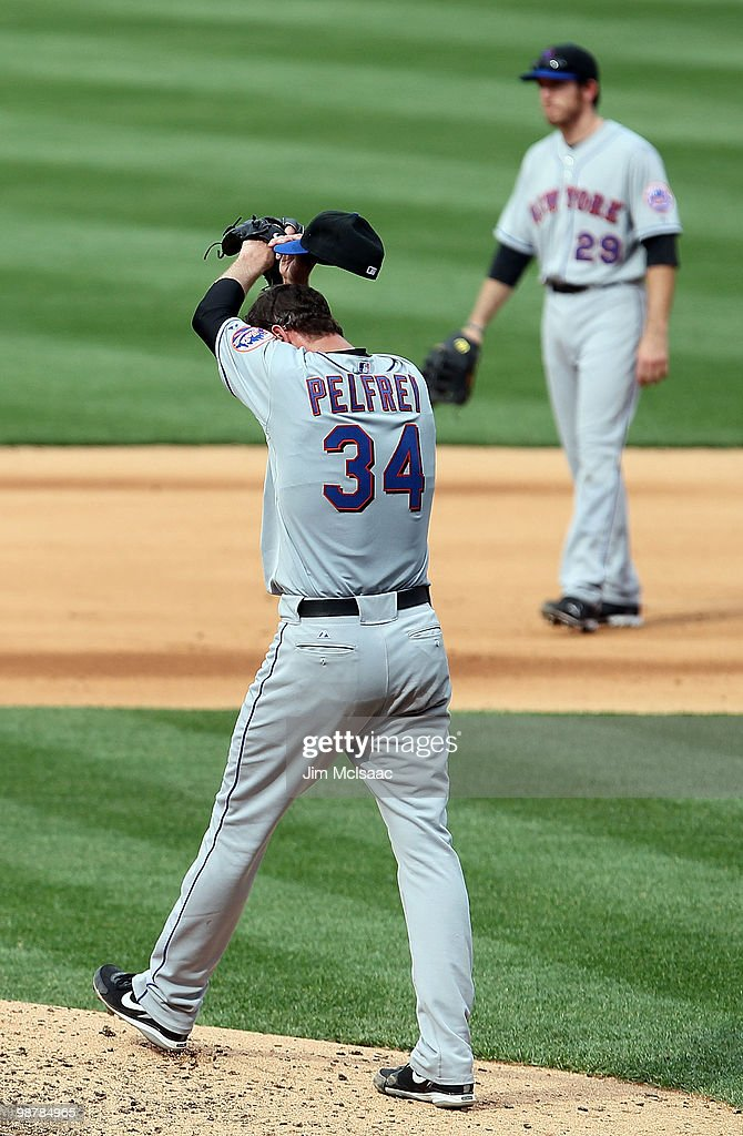 Mike Pelfrey #34 and <a gi-track='captionPersonalityLinkClicked' href=/galleries/search?phrase=Ike+Davis&family=editorial&specificpeople=2349664 ng-click='$event.stopPropagation()'>Ike Davis</a> #29 of the New York Mets react after surrendering a three run home run to Shane Victorino (not pictured) of the Philadelphia Phillies at Citizens Bank Park on May 1, 2010 in Philadelphia, Pennsylvania.