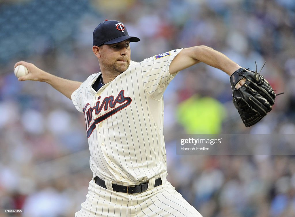 Mike Pelfrey #37 of the Minnesota Twins delivers a pitch against the Philadelphia Phillies during the first inning of the game on June 12, 2013 at Target Field in Minneapolis, Minnesota.