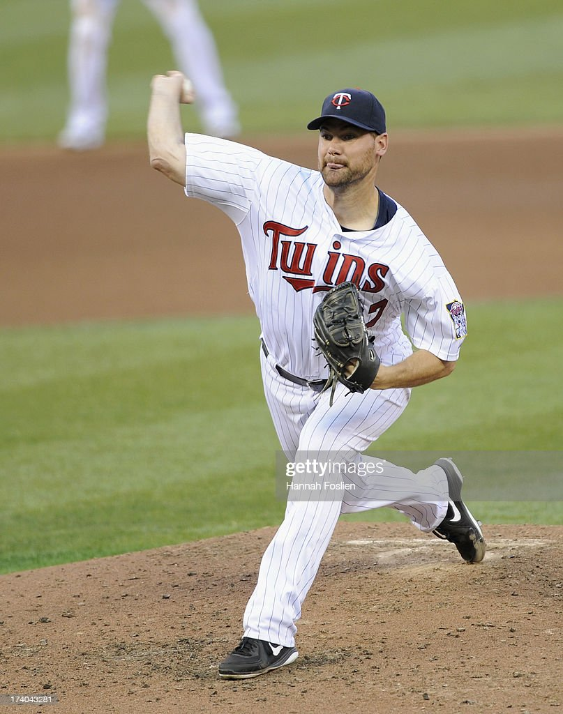 <a gi-track='captionPersonalityLinkClicked' href=/galleries/search?phrase=Mike+Pelfrey&family=editorial&specificpeople=836534 ng-click='$event.stopPropagation()'>Mike Pelfrey</a> #37 of the Minnesota Twins delivers a pitch against the Cleveland Indians during the fourth inning of the game on July 19, 2013 at Target Field in Minneapolis, Minnesota. The Twins defeated the Indians 3-2.