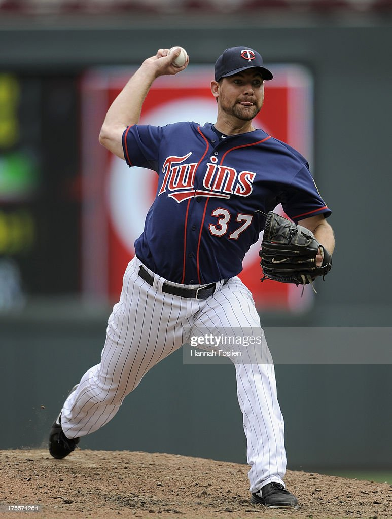 Mike Pelfrey #37 of the Minnesota Twins delivers a pitch against the Houston Astros during the fifth inning of the game on August 4, 2013 at Target Field in Minneapolis, Minnesota.