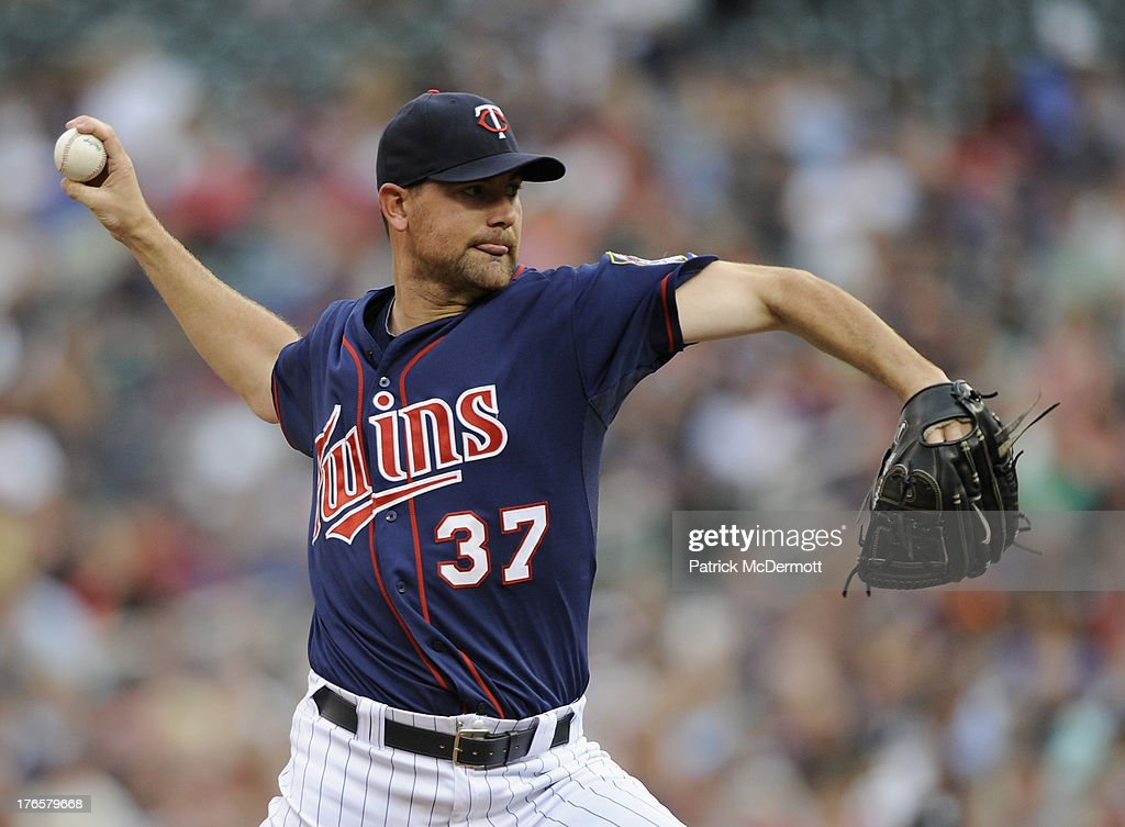 <a gi-track='captionPersonalityLinkClicked' href=/galleries/search?phrase=Mike+Pelfrey&family=editorial&specificpeople=836534 ng-click='$event.stopPropagation()'>Mike Pelfrey</a> #37 of the Minnesota Twins delivers a pitch against the Chicago White Sox during the first inning of the game on August 15, 2013 at Target Field in Minneapolis, Minnesota.
