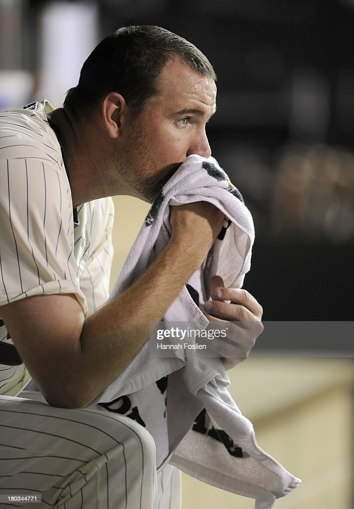 <a gi-track='captionPersonalityLinkClicked' href=/galleries/search?phrase=Mike+Pelfrey&family=editorial&specificpeople=836534 ng-click='$event.stopPropagation()'>Mike Pelfrey</a> #37 of the Minnesota Twins looks on from the dugout during the third inning of the game against the Oakland Athletics on September 11, 2013 at Target Field in Minneapolis, Minnesota.