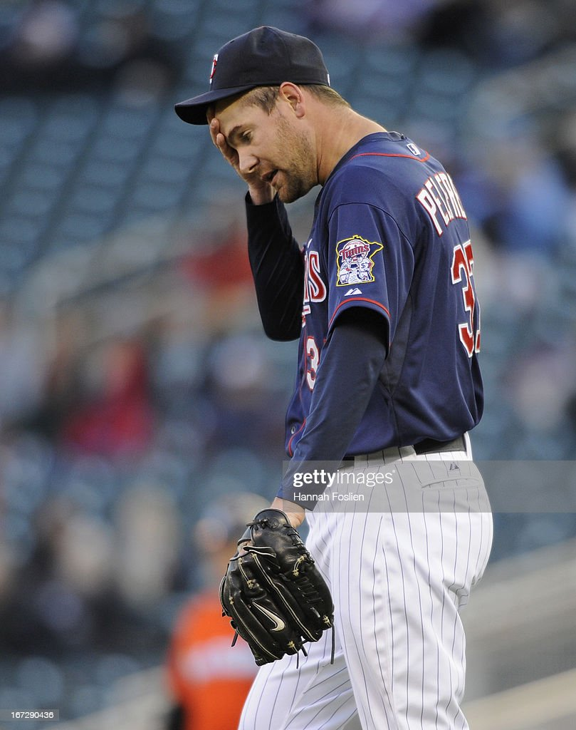 Mike Pelfrey #37 of the Minnesota Twins reacts during the first inning of the second game of a doubleheader against the Miami Marlins on April 23, 2013 at Target Field in Minneapolis, Minnesota.