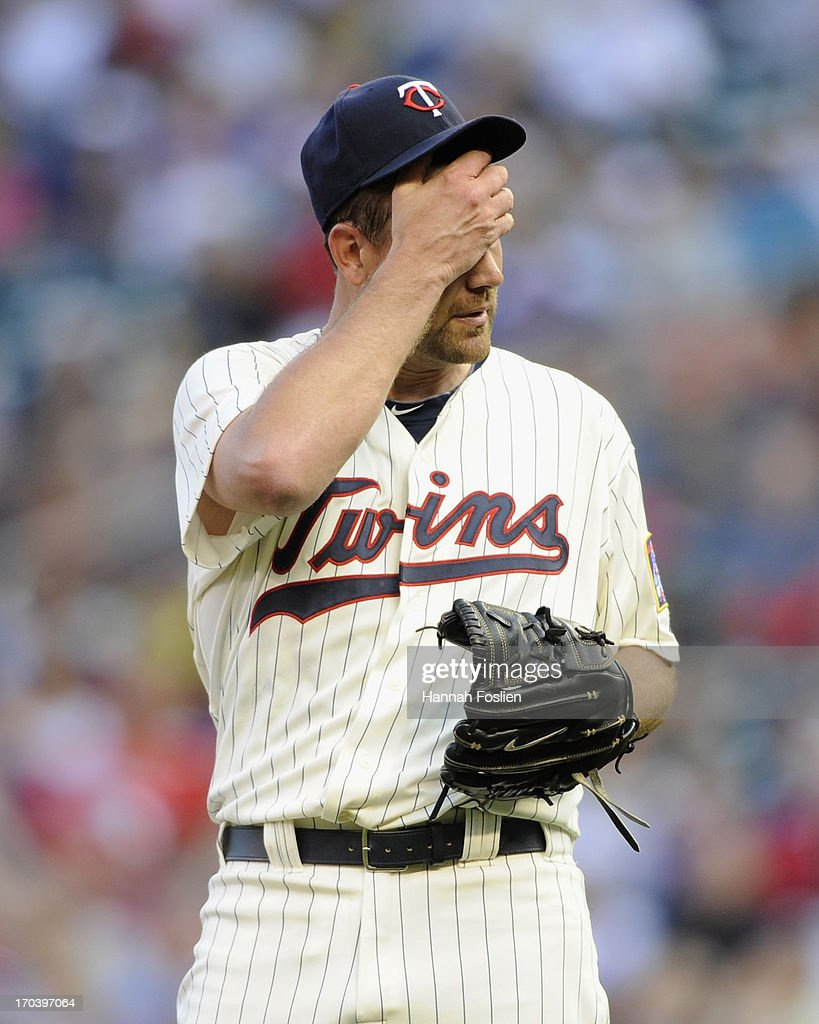 Mike Pelfrey #37 of the Minnesota Twins reacts to walking Ryan Howard #6 of the Philadelphia Phillies to load the bases during the first inning of the game on June 12, 2013 at Target Field in Minneapolis, Minnesota.