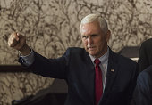 Mike Pence 2016 Republican vice presidential nominee gestures during a goodbye reception at the Westin Hotel in Cleveland Ohio US on Friday July 22...