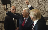 Mike Pence 2016 Republican vice presidential nominee left and Donald Trump 2016 Republican presidential nominee gesture to attendees during a goodbye...