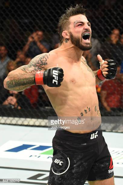 Mike Perry celebrates after defeating Alex Reyes in their welterweight bout during the UFC Fight Night event inside the PPG Paints Arena on September...