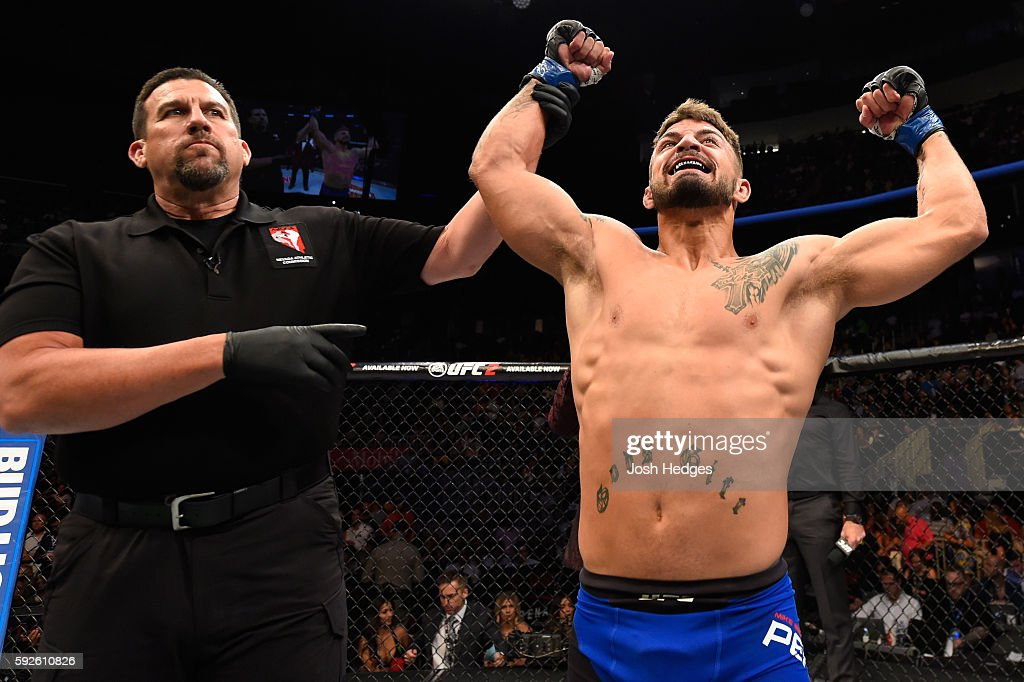 Mike Perry celebrates after defeating Hyun Gyu Lim of South Korea in their welterweight bout during the UFC 202 event at TMobile Arena on August 20...