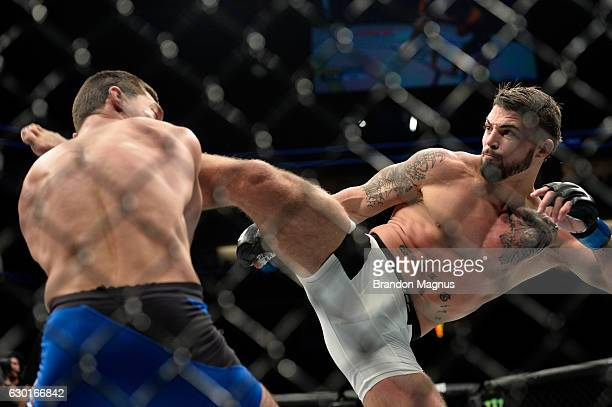 Mike Perry kicks Alan Jouban in their welterweight bout during the UFC Fight Night event inside the Golden 1 Center Arena on December 17 2016 in...