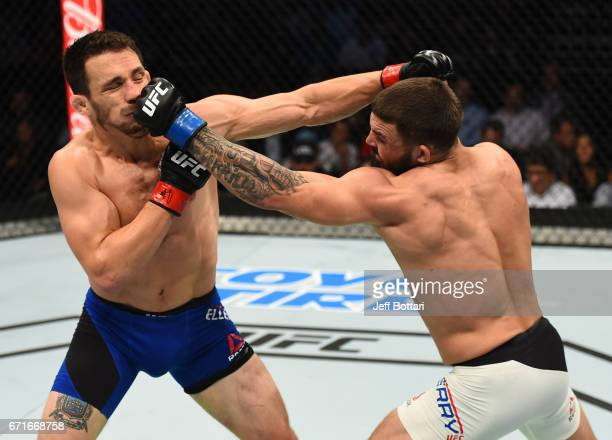 Mike Perry punches Jake Ellenberger in their welterweight bout during the UFC Fight Night event at Bridgestone Arena on April 22 2017 in Nashville...