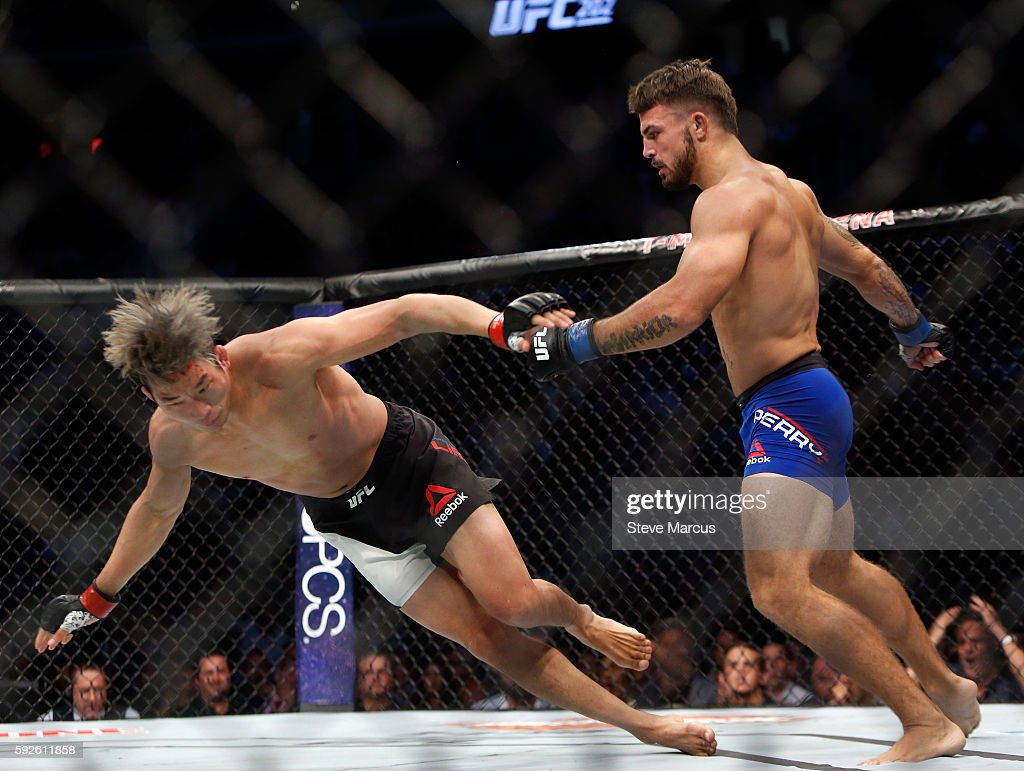 Mike Perry sends Hyun Gyu Lim to the canvas during their welterweight bout at the UFC 202 event at TMobile Arena on August 20 2016 in Las Vegas...