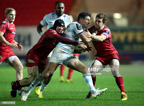 Mike Phillips of Racing 92 is tackled by James Davies of Scarlets during the European Rugby Champions Cup match between Scarlets and Racing 92 at the...