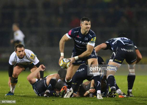 Mike Phillips of Sale Sharks passes the ball out from a scrum during the Aviva Premiership match between Sale Sharks and Northampton Saints at AJ...