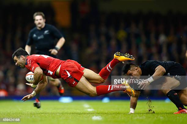 Mike Phillips of Wales is tackled by Keven Mealamu of the All Blacks during the Intenational match between Wales and the New Zealand All Blacks at...