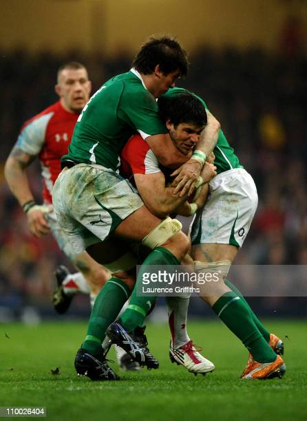 Mike Phillips of Wales is wrapped up by Donncha O'Callaghan and Jamie Heaslip of Ireland uring the RBS Six Nations Championship match between Wales...