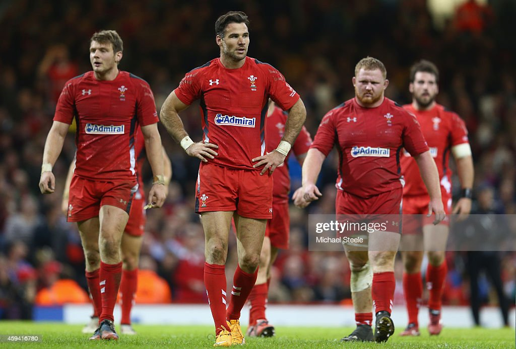 Mike Phillips (C) of Wales looks dejected after his side concede a fourth try during the International match between Wales and New Zealand at the Millennium Stadium on November 22, 2014 in Cardiff, Wales.