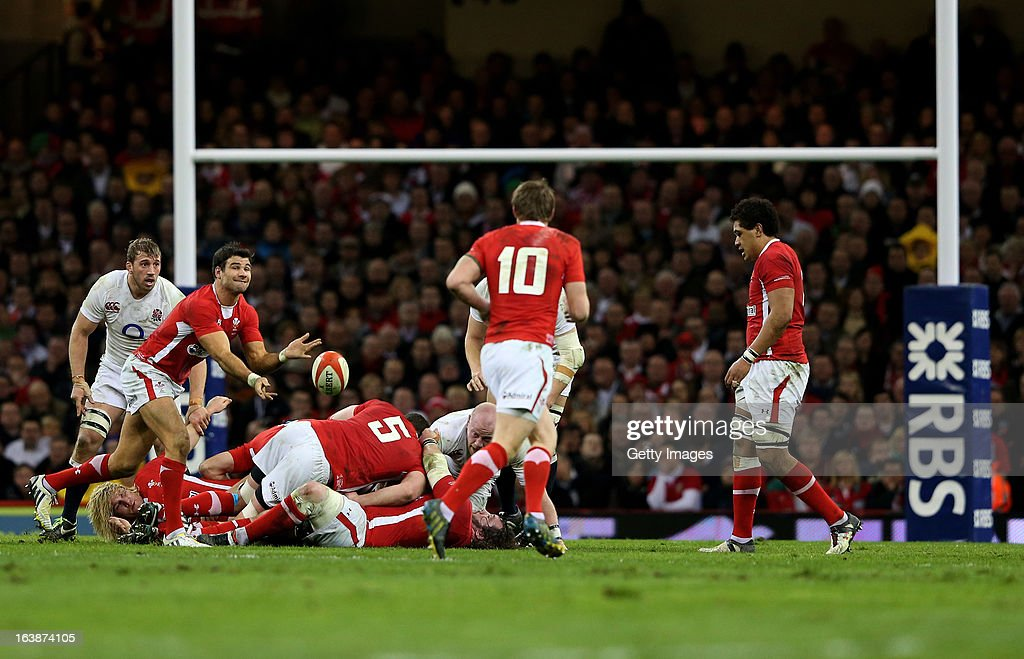 Mike Phillips of Wales passes the ball during the RBS Six Nations match between Wales and England at Millennium Stadium on March 16, 2013 in Cardiff, Wales.