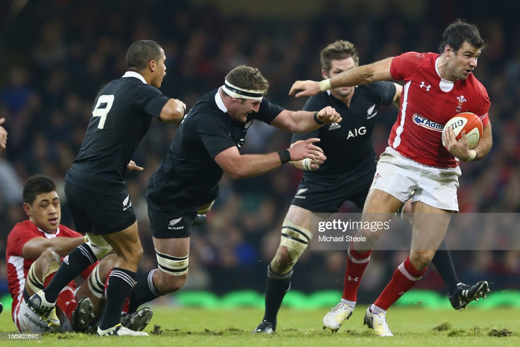 Mike Phillips (R) of Wales pulls away from the challenge of <a gi-track='captionPersonalityLinkClicked' href=/galleries/search?phrase=Richie+McCaw&family=editorial&specificpeople=165235 ng-click='$event.stopPropagation()'>Richie McCaw</a> (2R), <a gi-track='captionPersonalityLinkClicked' href=/galleries/search?phrase=Kieran+Read&family=editorial&specificpeople=789465 ng-click='$event.stopPropagation()'>Kieran Read</a> (2L) and Aaron Smith (L) of New Zealand during the International match between Wales and New Zealand at the Millennium Stadium on November 24, 2012 in Cardiff, Wales.