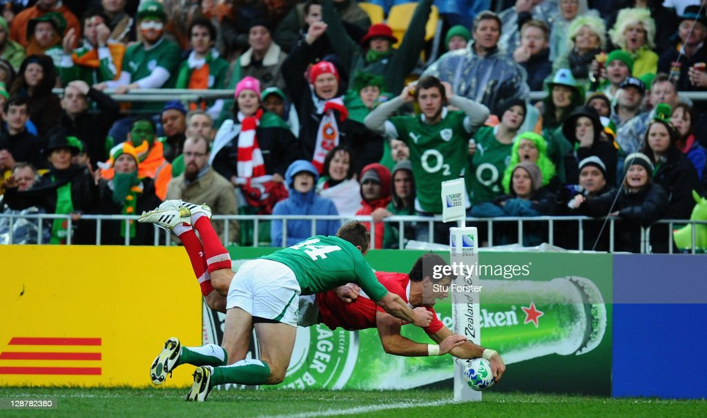 Mike Phillips of Wales (R) touches over the line to score their second try despite the challenge of Tommy Bowe of Ireland during quarter final one of the 2011 IRB Rugby World Cup between Ireland v Wales at Wellington Regional Stadium on October 8, 2011 in Wellington, New Zealand.