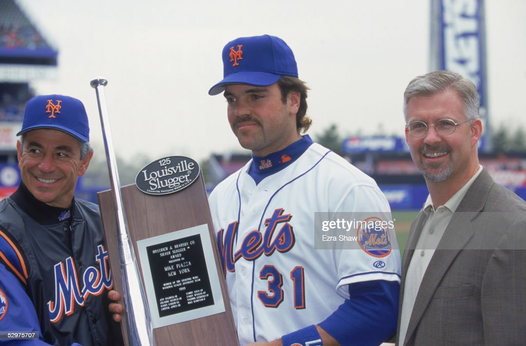 Mike Piazza manager Bobby Valentine and general manager Steve Phillips pose for a portrait with the Sporting News Hillerich Bradsby C Silver Slugger...
