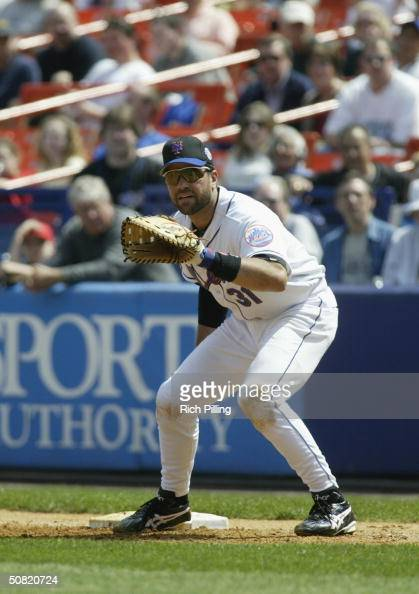 Mike Piazza of the New York Mets attempts to catch the ball during the game against the Montreal Expos at Shea Stadium on April 22 2004 in Flushing...