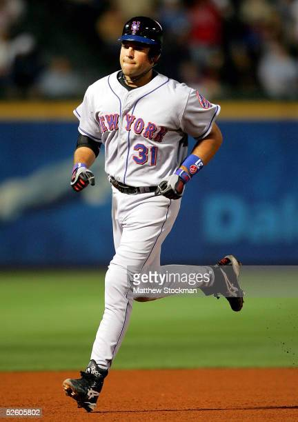 Mike Piazza of the New York Mets circles the bases after hitting a solo home run in the fourth inning against the Atlanta Braves at Turner Field on...