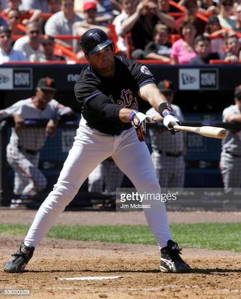 Mike Piazza of the New York Mets hits a two run single in the fifth inning scoring teammates Jose Reyes and Mike Cameron giving the Mets a 31 lead...