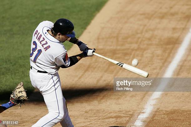 Mike Piazza of the New York Mets puts the bat on the ball during the game against the Montreal Expos at Shea Stadium on October 3 2004 in Flushing...