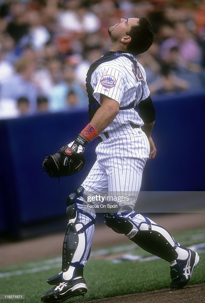 Mike Piazza #31 of the New York Mets tracks a foul ball during a MLB baseball game circa 2002 at Shea Stadium in the Queens borough of New York City. Piazza played for the Mets from 1998-2005.
