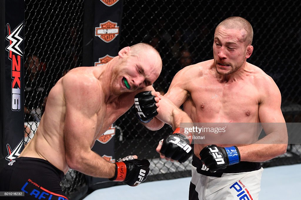 Mike Pierce punches Ryan LaFlare in their welterweight bout during the TUF Finale event inside The Chelsea at The Cosmopolitan of Las Vegas on December 11, 2015 in Las Vegas, Nevada.
