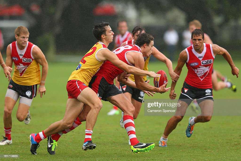 Mike Pike of the Swans is tackled during an intra-club practice match during a Sydney Swans AFL training session at Moore Park on February 15, 2013 in Sydney, Australia.