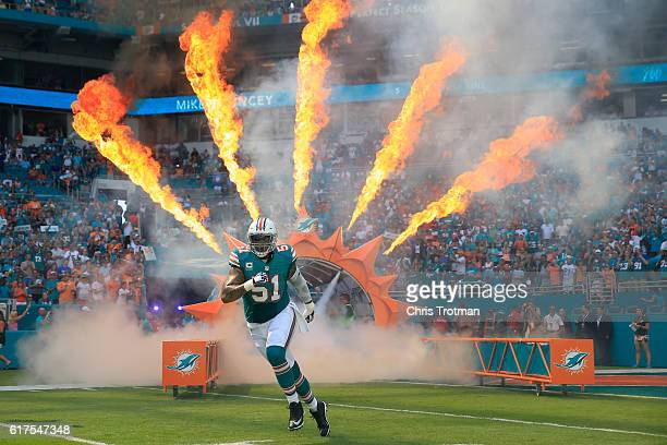 Mike Pouncey of the Miami Dolphins enters the field prior to a game against the Buffalo Bills at Hard Rock Stadium on October 23 2016 in Miami...