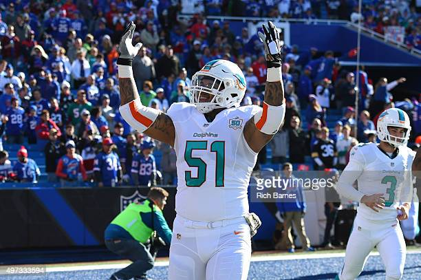 Mike Pouncey of the Miami Dolphins gestures to the crowd prior to the game against the Buffalo Bills at Ralph Wilson Stadium on November 8 2015 in...