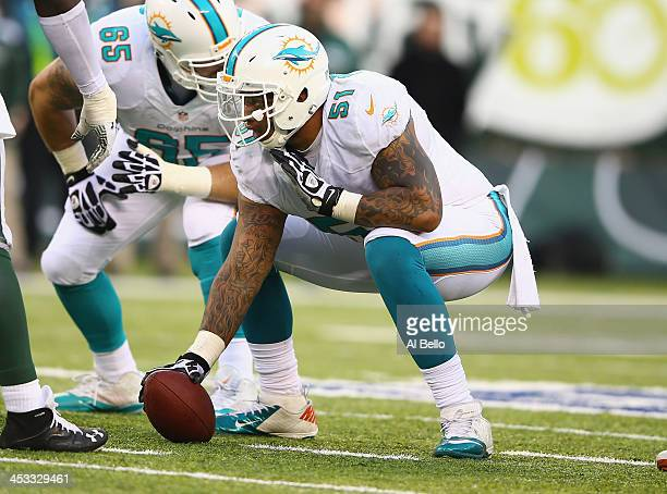 Mike Pouncey of the Miami Dolphins in action against the New York Jets during their game at MetLife Stadium on December 1 2013 in East Rutherford New...