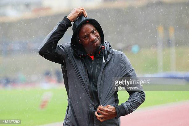 Mike Powell of USA looks on after pulling out injured from the senior men's long jump final during the New Zealand Track Field Championships at...