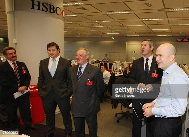 Mike Powell R gives a tour of the trading floor to former Lions players Gerald Davies Paul Wallace Gareth Edwards and Gavin Hastings prior to the...