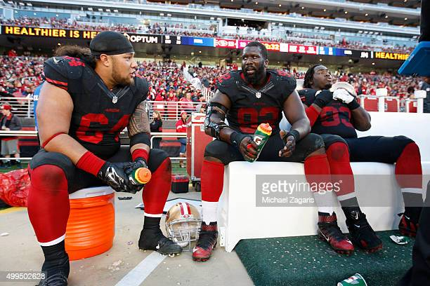 Mike Purcell Quinton Dial and Ian Williams of the San Francisco 49ers relax on the sideline during the game against the Arizona Cardinals at Levi...