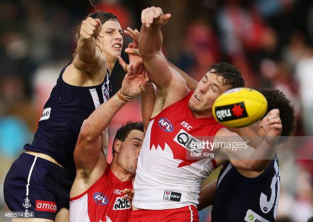 Mike Pyke and Luke Parker of the Swans compete for the ball against Nat Fyfe of the Dockers during the NAB Challenge AFL match between the Sydney...