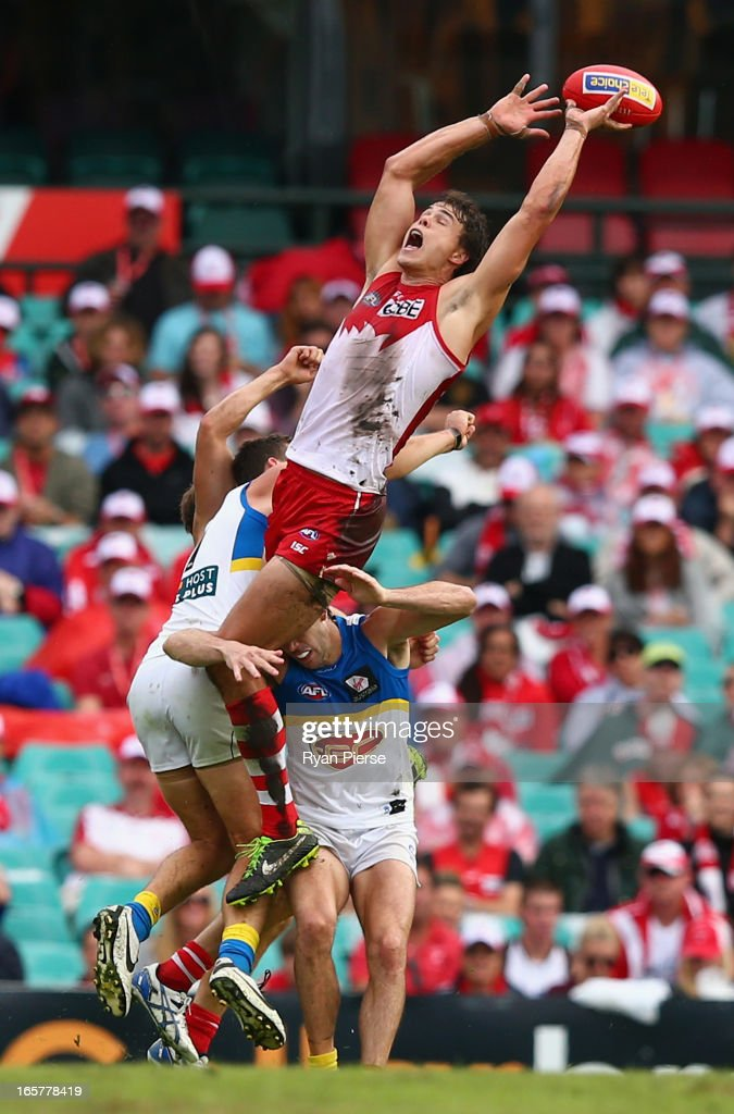 Mike Pyke of the Swans leaps for a mark during the round two AFL match between the Sydney Swans and the Gold Coast Suns at SCG on April 6, 2013 in Sydney, Australia.