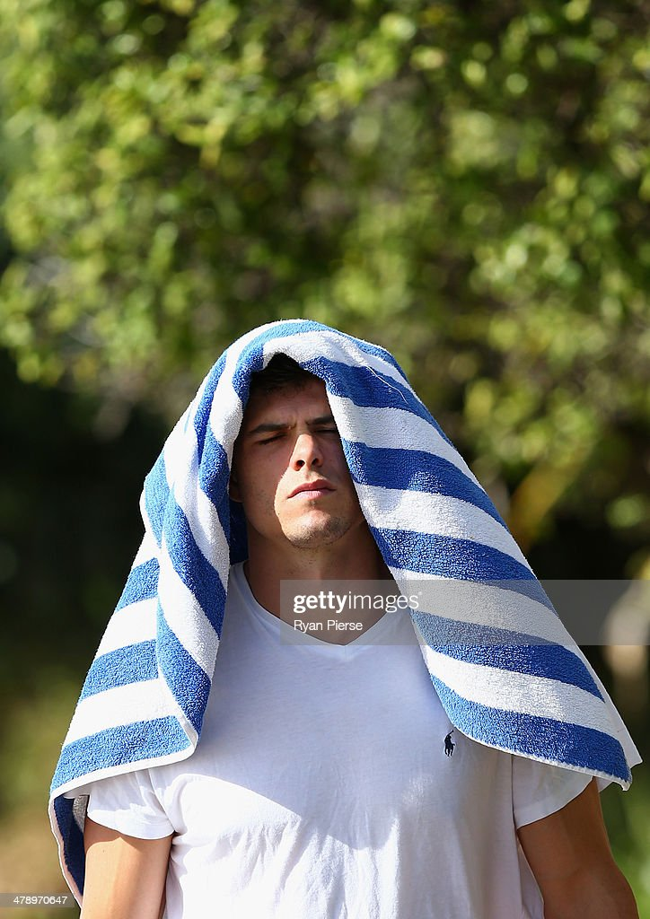 Mike Pyke of the Swans looks on during a Sydney Swans AFL recovery session at Coogee Beach on March 16, 2014 in Sydney, Australia.