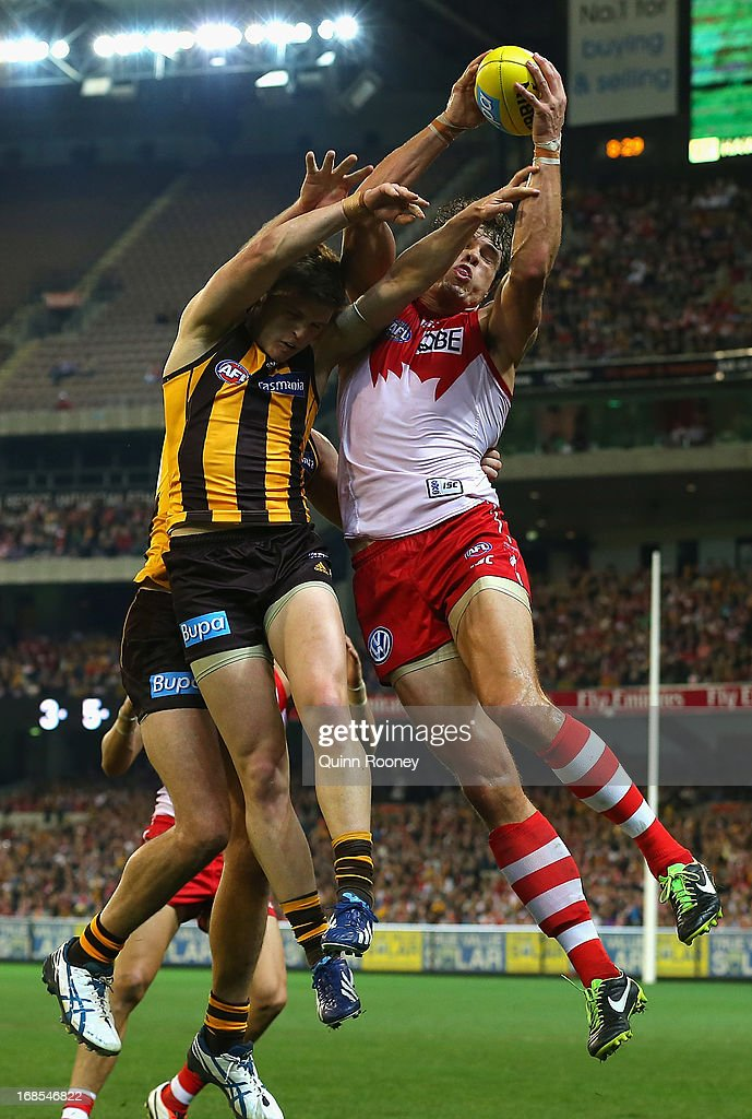 Mike Pyke of the Swans marks during the round seven AFL match between the Hawthorn Hawks and the Sydney Swans at Melbourne Cricket Ground on May 11, 2013 in Melbourne, Australia.