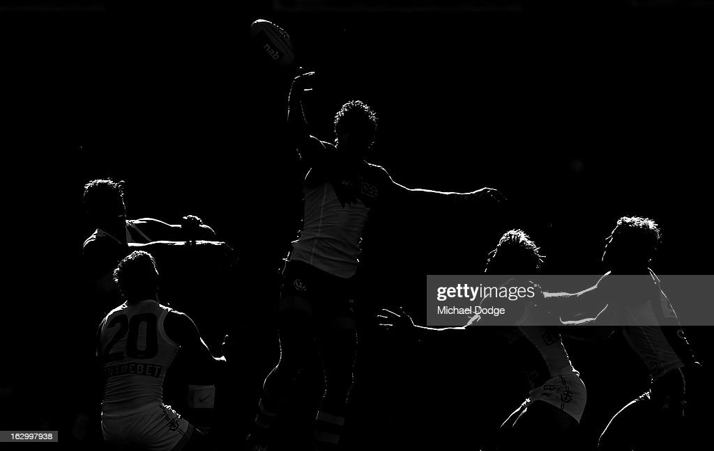 Mike Pyke of the Sydney Swans taps the ball during the round two AFL NAB Cup match between the St Kilda Saints and the Sydney Swans at Etihad Stadium on March 3, 2013 in Melbourne, Australia.